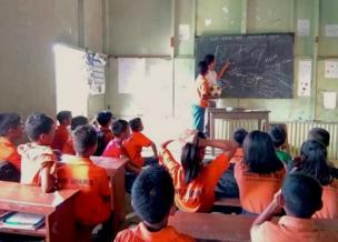 """A teacher explains the """"beautiful game"""" to a classroom of students in India."""