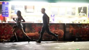 woman and man running