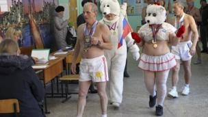 Members of the 'Polar Bear' winter swimming club vote in Barnaul, Russia, on 18 March 2018