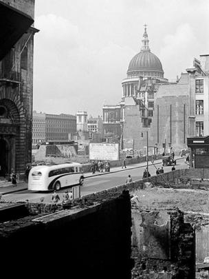 Looking south-west across bomb-damaged buildings on Cheapside towards St Paul's cathedral