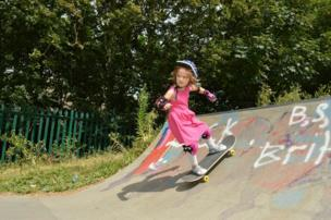 A young girl skateboarding