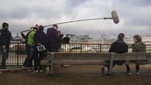 Filming a scene from Red Nose Day Actually