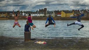 The moment a group of swimmers decided to take the plunge at Elie Harbour