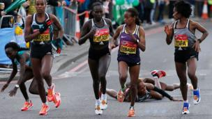 Runners fall after a water station
