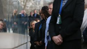 A minute's silence is observed outside New Scotland Yard