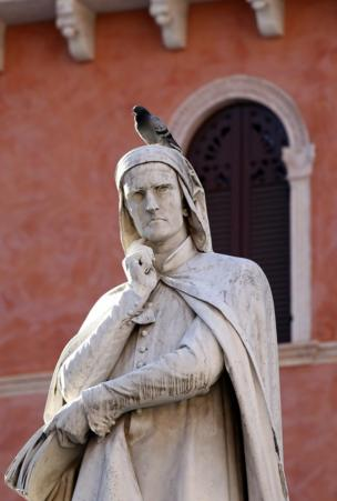A pigeon on top of a statue