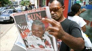 Man reading newspaper after 2006 coup in Fiji