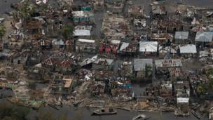 Destroyed houses are seen in a village after Hurricane Matthew passes Corail in Haiti