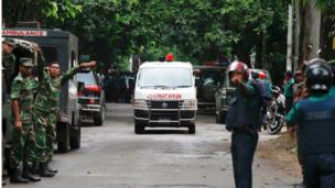 An ambulance transports bodies found at a restaurant popular with foreigners after heavily armed militants attacked it on Friday night in Dhaka, Bangladesh, Saturday, 2 July 2016
