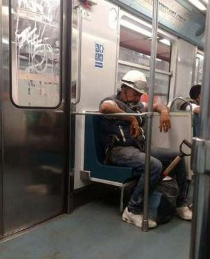 Mexico City transport system praise di work of di volunteers and rescue workers with tweet of di photo of one tired emergency worker wey dey travelling for di city metro.