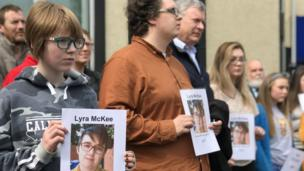 """Several dozen people attended a vigil organised by Mid Ulster Trade Union Council in Cookstown holding photos of Lyra McKee and the message: """"We Stand with Lyra"""""""
