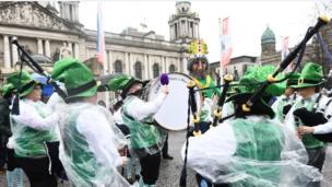 St Patrick oversaw the rain-soaked festivities at Belfast City Hall