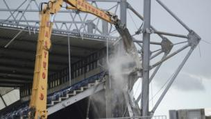 Following a structural engineer's report, work started to demolish the damaged west stand at Windsor Park. A new stand is currently in development.
