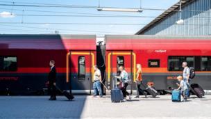 Passengers beside a train