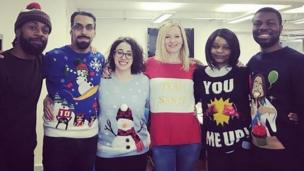Staff wearing an assortment of Christmas jumpers