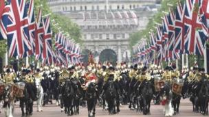Guardsmen arrive back at Buckingham Palace from Horse Guards Parade after the annual Trooping the Colour ceremony in central London