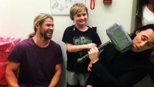 Chris Hemsworth and Tom Hiddleston visiting a children's hospital