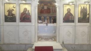This Greek Orthodox churchz altar survived tha blast unscathed - even its oil lamp stayed lit