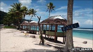 Fales on a beach in Samoa