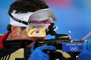 Ole Einar Bjoerndalen of Norway shoots his rifle.