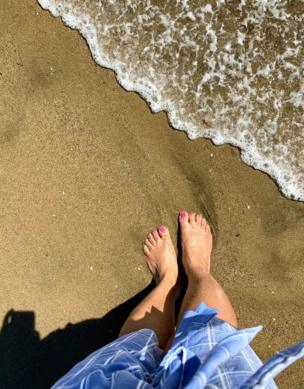 Painted toes on the shore line