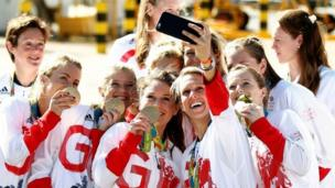 Team GB athletes pose with their medals for selfies as they return home from the 2016 Rio Olympics, at Heathrow Airport in London