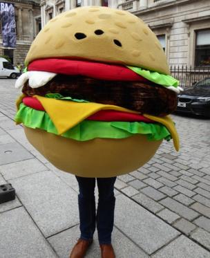 Man in a burger costume
