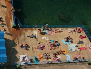 Looking down onto sunbathers on a deck