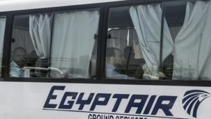 Family members of passengers who were flying aboard an EgyptAir plane that vanished from radar en route from Paris to Cairo overnight are transported by bus to a gathering point at Cairo airport on 19 May 2016.