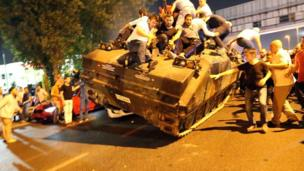 People occupy a tank in Istanbul