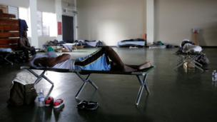 People who were evacuated from their homes are seen in a room at a soccer stadium being used as a shelter while Hurricane Matthew approaches Kingston, Jamaica October 3, 2016.