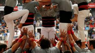 "Castellers de Sants start to form a human tower called ""castell"" during a biannual competition in Tarragona city, Spain, October 2, 2016."
