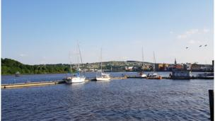 A near cloudless sky over the River Foyle in Londonderry