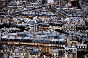 An aerial view of the houses and streets of Paris