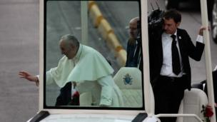 Pope Francis (L) greets people from his Popemobile after arriving at the CATAM airfield in Bogotá, Colombia, 06 September 2017.