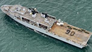 "Members of the ship's company on HMS Bulwark created a ""90"" on the flight deck of the amphibious assault ship"