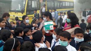 Teachers distributing masks