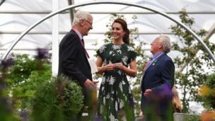The Duchess of Cambridge talks with exhibitors
