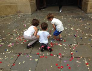 Children play with confetti on the ground