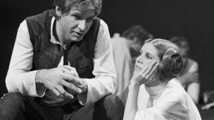 Harrison Ford talks with Carrie Fisher during a break in the filming of the CBS-TV special The Star Wars Holiday in Los Angeles on 13 Nov, 1978