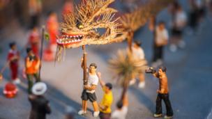 Fire dragon dance in miniature