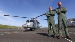 Lt Cdr Marty van Duin (pilot) and Lt Cdr Chris Grey (observer) with the Royal Navy Wildcat HMA2