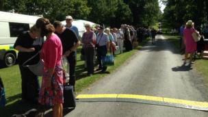 The queue of visitors stretches down the avenue leading to Helmingham Hall