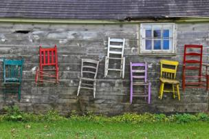 Chairs on the outside of a home