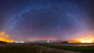 The Milky Way with the Northern Lights over Trwyn Du Lighthouse, near Penmon, Anglesey