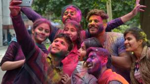 Friends taking pictures after Holi