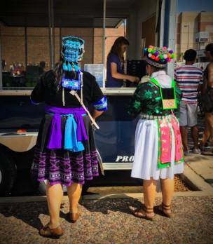 Two Hmong American women take a break