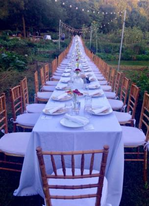 A long table is dressed to seat 120 people