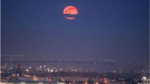 Strawberry moon over the bay in San Diego, US. Credit: Ryan Rosas