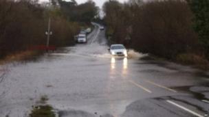 Cars and lorries on New Bridge Road between Derrylin and Lisnaskea